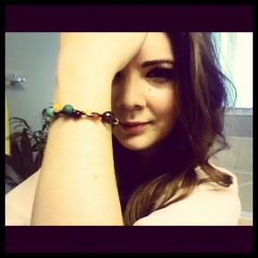 "RSJ founder Gillian Kemmerer wears the ""Jungle Bracelet."""